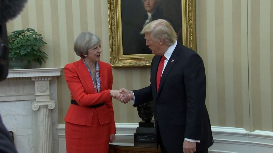 Theresa May shakes hands with Donald Trump with Winston Churchill bust in background