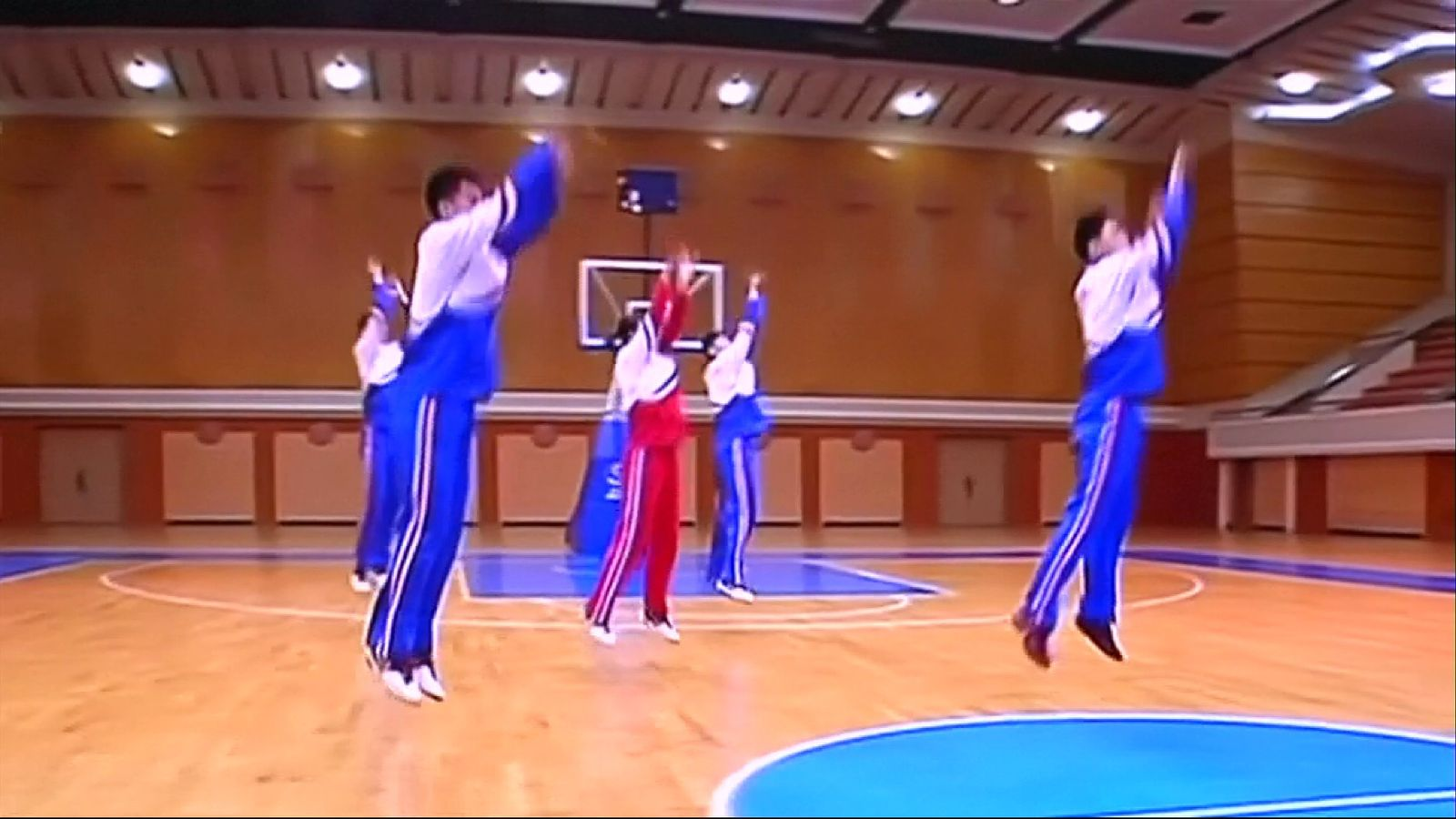 Basketball players using gymnastics techniques in Pyongyang
