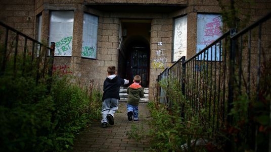 Two young boys play football in the street, September 30, 2008 in the Govan area of Glasgow, Scotland