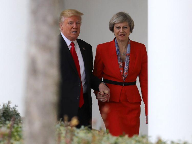 Donald Trump and Theresa May hold hands