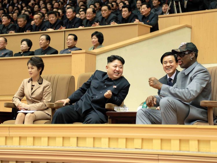 Kim Jong-Un watches a basketball game with Dennis Rodman in 2014