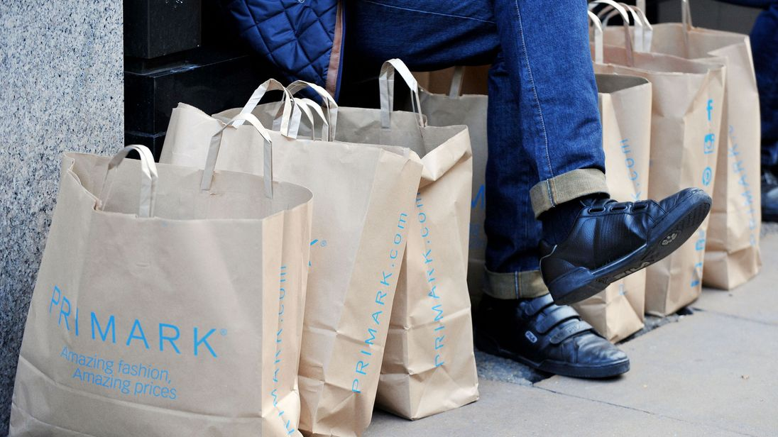 File photo dated 04/11/14 of a man surrounded by Primark bags in London