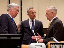 (L-R) Michael Fallon, Jens Stoltenberg and James Mattis