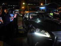 A North Korean embassy official leaves Kuala Lumpur General hospital