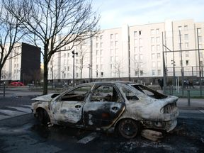 Cars were set alight in a night of unrest following the alleged sexual assault