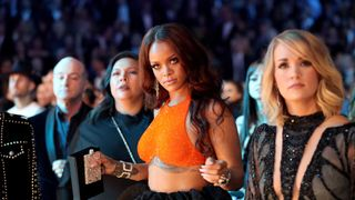 Riri pulled off a custom tangerine Armani Prive crop top with crystals and a voluminous black skirt of silk organza