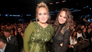 Adele wearing Givenchy Haute Couture by Ricardo Tisci next to Chrissy Teigen