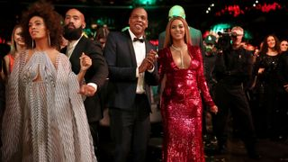 Beyonce emerged from the audience in red sequins with Jay Z and sister Solange
