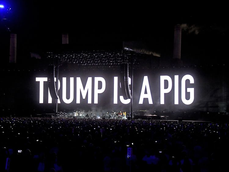 An illustration of Donald Trump appears on the screen during Roger Waters performance