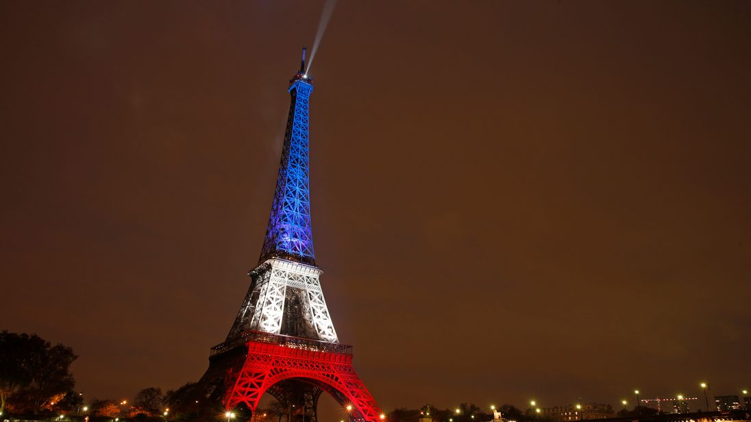 The Eiffel Tower in Paris lit up in the colours of the French flag