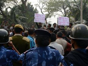 Protesters against the child trafficking scandal in Jalpaiguri