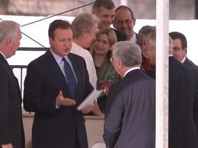 David Cameron appears to tell Defence Secretary Sir Michael Fallon what he thinks of the Budget