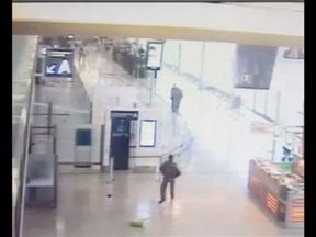 The attacker, known as Ziyed B, can be seen with the hostage as security officers close in