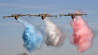 Civil security aircrafts parade during the inauguration of the Nimes-Garons civil security air force base in southern France