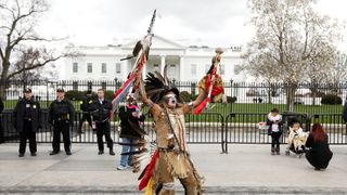 Little Thunder, a traditional dancer and indigenous activist from the Lakota tribe, dances as he demonstrates in front of the White House