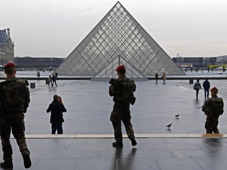 Soldiers on Operation Sentinelle patrol outisde the Louvre