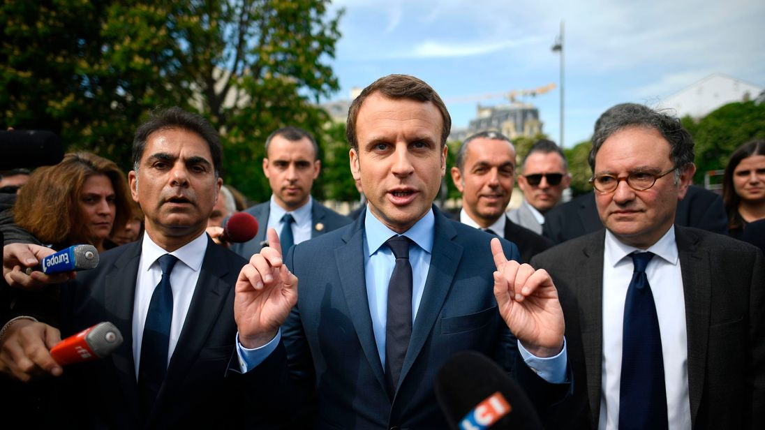 French presidential election candidate for the En Marche ! movement Emmanuel Macron (C), next to Mourad Franck Papazian (L), co-president of France's Armenian Organizations Coordination Council (CCAF, Conseil de Coordination des organisations Armenienne de France), speaks to the press after a ceremony at a monument in memory of mass killings of Armenians by Ottoman forces in 1915, on April 24, 2017 in Paris