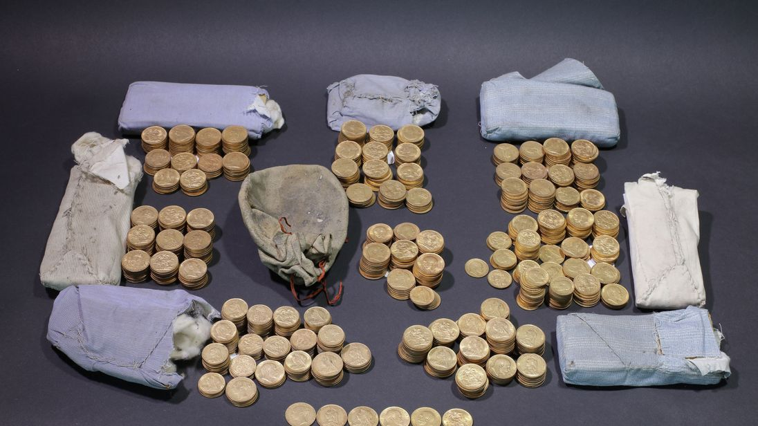 This hoard of century-old gold coins were found hidden in an upright piano.