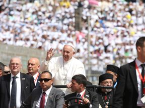 Pope Francis waves to the crowds