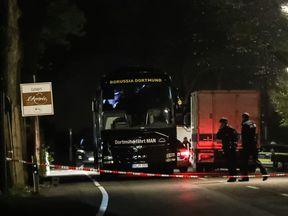 Police stand near the team bus of the Borussia Dortmund football club