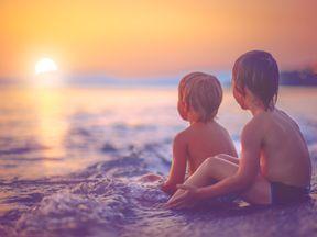 Children enjoying a sunset on holiday