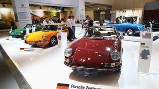 1961 Porsche 356 Roadster (dark green), 1975 911 2.7 Targa (green), 1972 911T 2.2 Coupe (orange) and 1969 911E 2.0 Coupe (red)