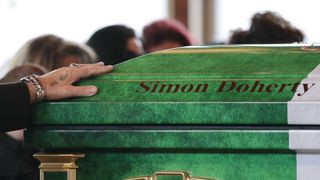 The coffin was painted in the colours of the Irish flag