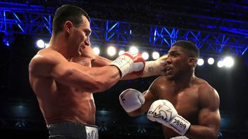 Anthony Joshua (White Shorts) and Wladimir Klitschko (Gray Shorts) in action during the IBF, WBA and IBO Heavyweight World Title bout at Wembley Stadium