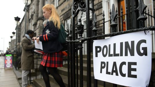 A young voter leaves a polling station after casting her vote in Edinburgh, Scotland, on September 18, 2014, during a referendum on Scotland's independence