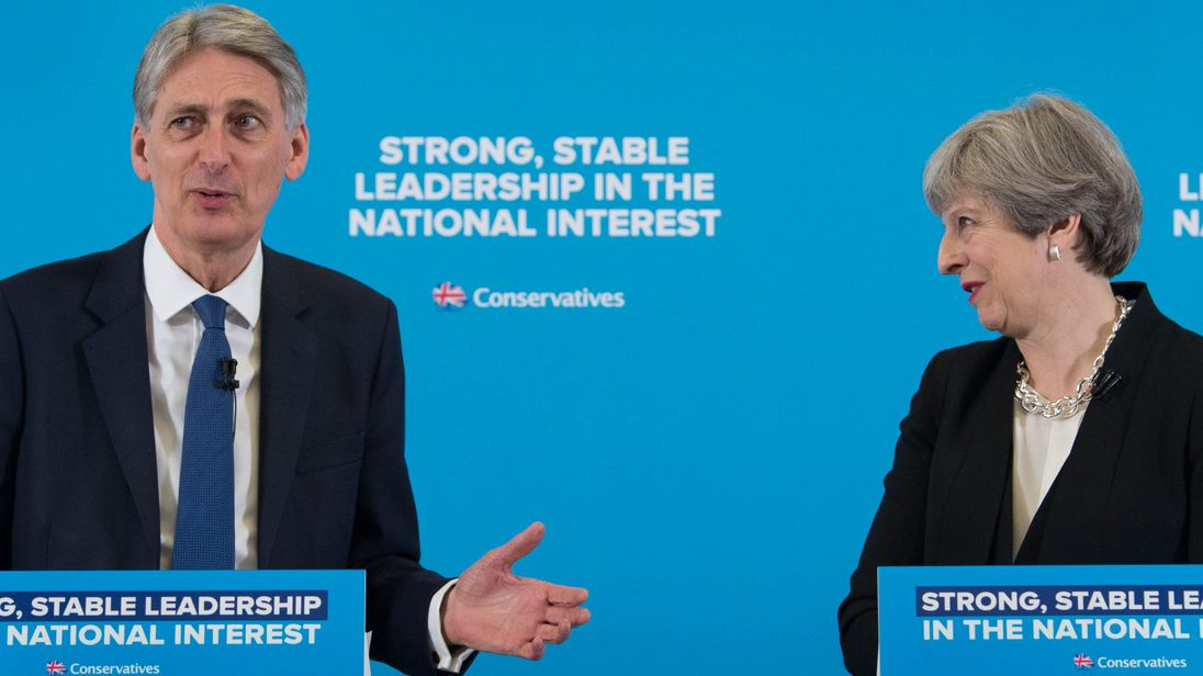 Theresa May and Philip Hammond during a general election campaign event in east London
