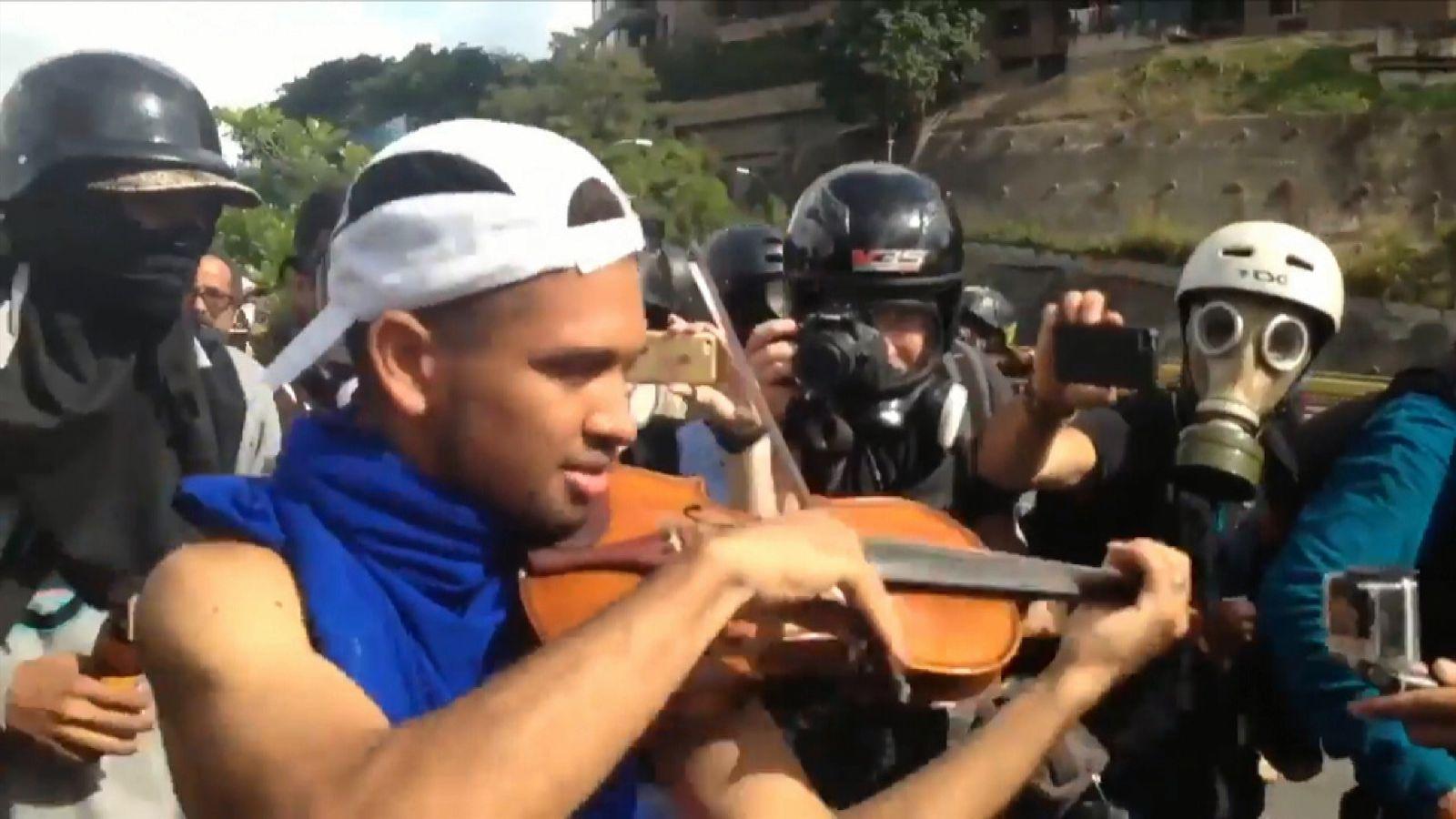 Protester plays violin amid anti-government march in Venezuela