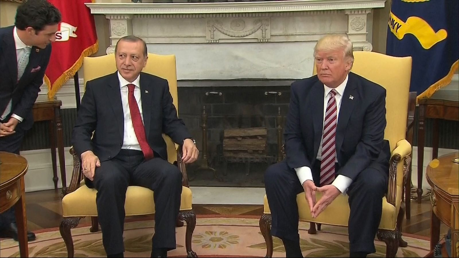 Donald Trump blanks questions from journalists about classified information and Russia while the President of Turkey looks on
