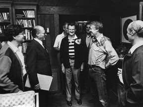 Advisor Zbigniew Brzezinski (c) and President Jimmy Carter (second from left) during a 1978 summit, which resulted in the Camp David Accords