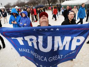 WASHINGTON, DC - JANUARY 20: US President Donald Trump supporters react on the National Mall to the inauguration of US President Donald Trump on January 20, 2017