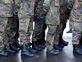 FILE PHOTO: Soldiers of the German armed forces Bundeswehr take part in farewell ceremony for Panzergrenadierbataillon 122, deployment in Lithuania, in Oberviechtach, Germany January 19, 2017