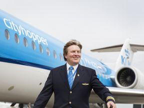 Dutch King Willem-Alexander in front of a KLM Cityhopper aircraft at Schiphol Airport, near Amsterdam