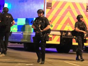 Armed police at Manchester Arena after the deadly explosion
