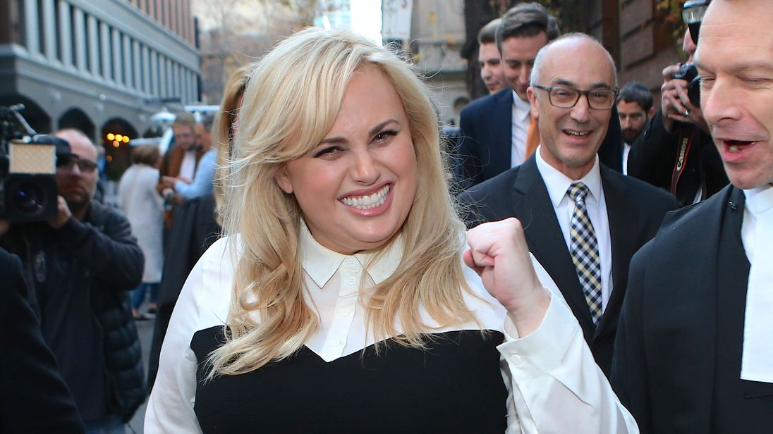 Rebel Wilson reacts as she leaves the Victorian Supreme Court in Melbourne