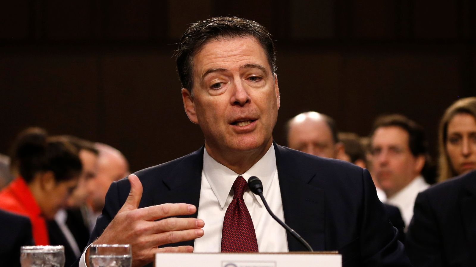 Former FBI Director James Comey testifies before a Senate Intelligence Committee hearing