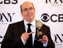 "Christopher Ashley poses with his award for Best Direction of a Musical for ""Come From Away."""
