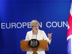Theresa May addresses a news conference at the EU summit in Brussels