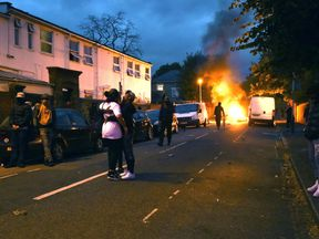 Campaigners face off with police in Richmond Road in Forest Gate