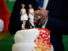 People celebrated with cake after same-sex marriage was voted in
