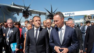 RTS17OG019 Jun. 2017Le Bourget, FranceFrench President Emmanuel Macron (C) and President and CEO of Airbus Fabrice Bregier (R) visit the 52nd Paris Air Show in Le Bourget, north of Paris, France, June 19, 2017. REUTERS/Michel Euler/Pool