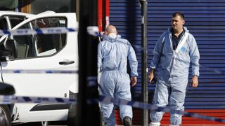 Forensic teams work at Finsbury Park following the terror attack