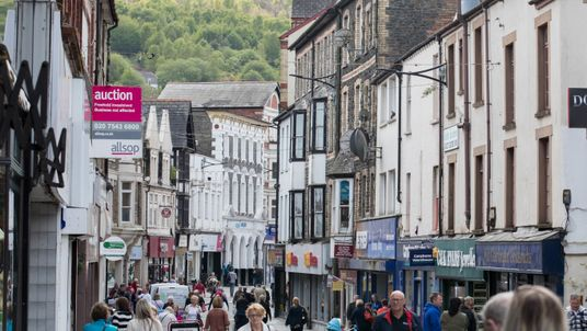 People past shops and businesses on May 5, 2017 in Pontypridd, Wales
