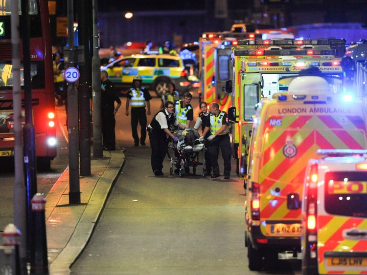 Police officers and members of the emergency services attend to a person injured in an apparent terror attack on London Bridge in central London on June 3, 2017