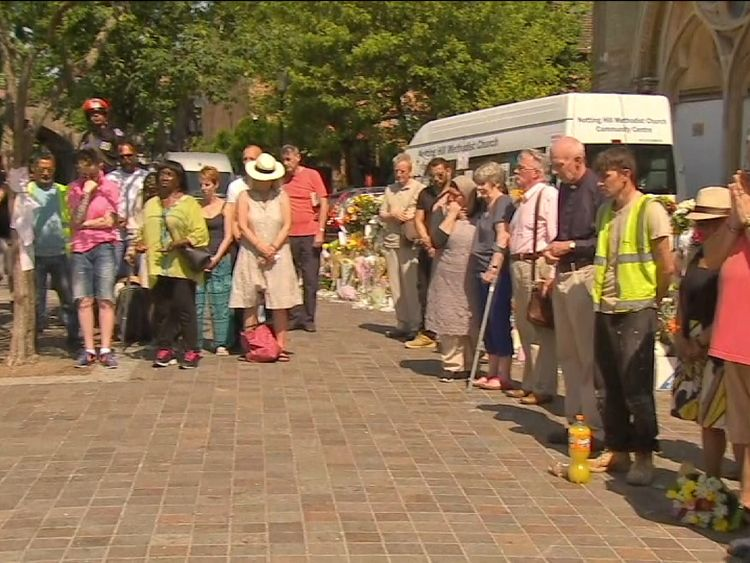 Residents observe a minute's silence near Grenfell Tower