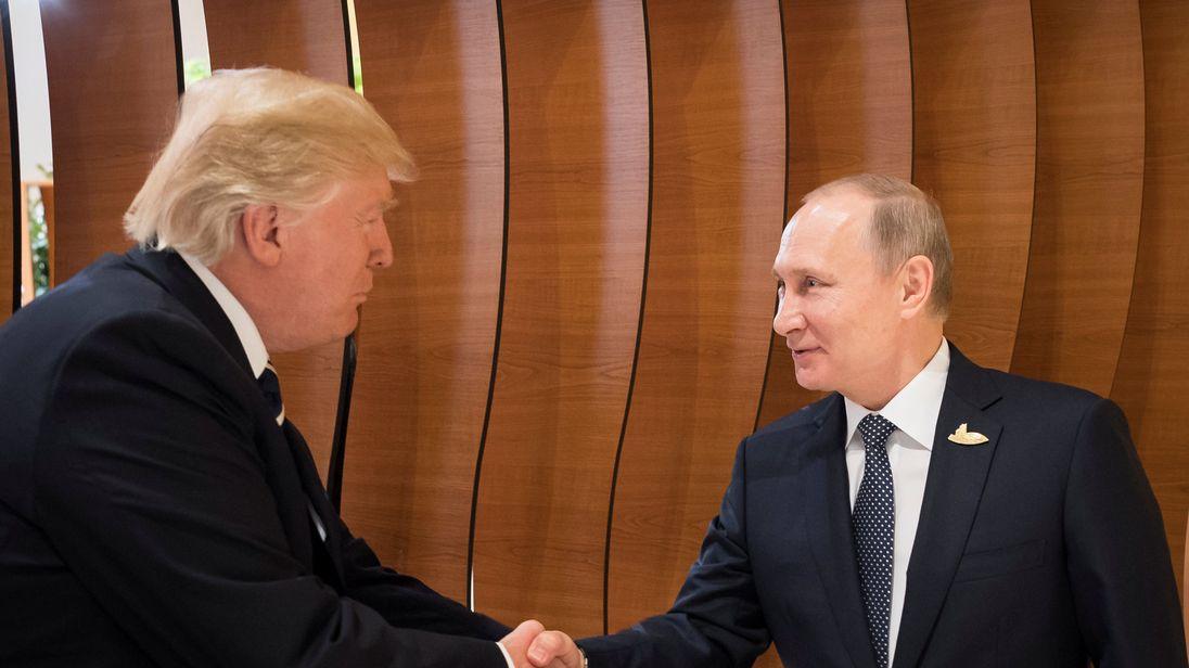 U.S. President Donald Trump and Russia's President Vladimir Putin shake hands