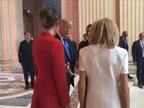 "Donald Trump gestures at ""beautiful"" Brigitte"